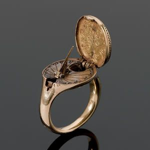 A rare 16th century gold sundial and compass ring, possibly German, circa 1570.  Arrgggh, she be a beauty.  Pirates!