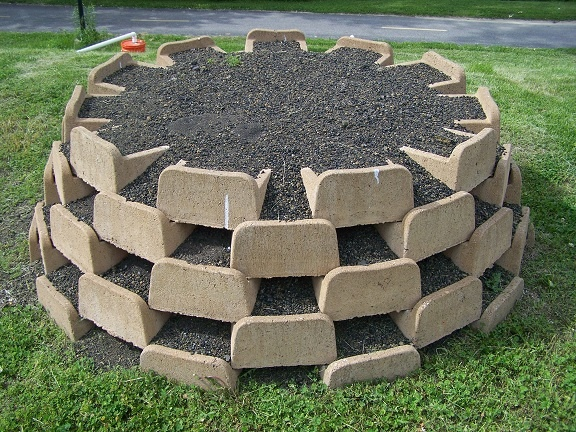 The blocks are created especially for planting living walls - see the open space for planting? Great for Strawberries.