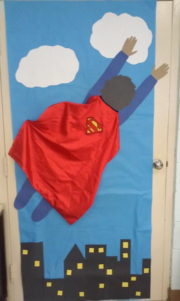 superman classroom door made with my son's cape. superhero theme