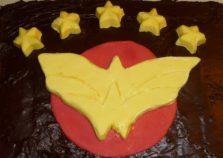 Wonder Woman Cake  Took a crack at making a birthday cake for my wife with the Wonder Woman logo on it. Being far from a professional, it didn't turn out too pretty, but recognizable I think. Still not too bad considering it was me that did the hand carving of the chocolate. It sure tasted good!