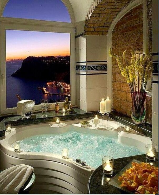 Jacuzzi tub. Nice bathroom. Does the view come with it??  Sweet!