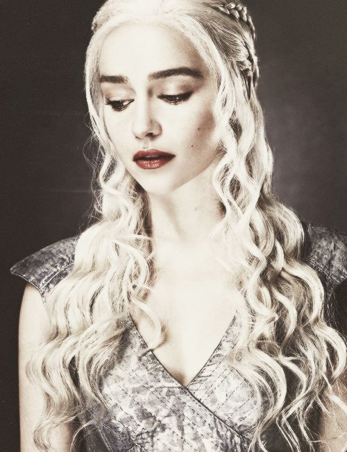 Daenerys Targaryen ~ Game of Thrones. I'm not unhappy that the show keeps her hair long despite it being burned off from the funeral pyre in the books. The actress is gorgeous in her full make-up.