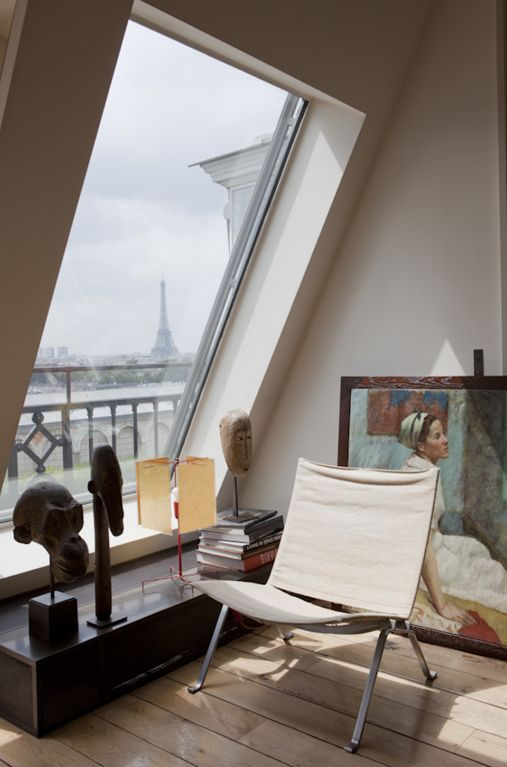 Paris apartment interiors.  I love this window!  Great for star viewing from the warmth of your favorite chair.