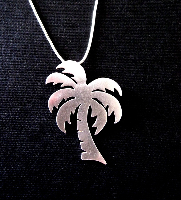 Tropical bliss! A little silver palm tree pendant. A reminder of perfect sunset holidays.  A commission created in 2008.