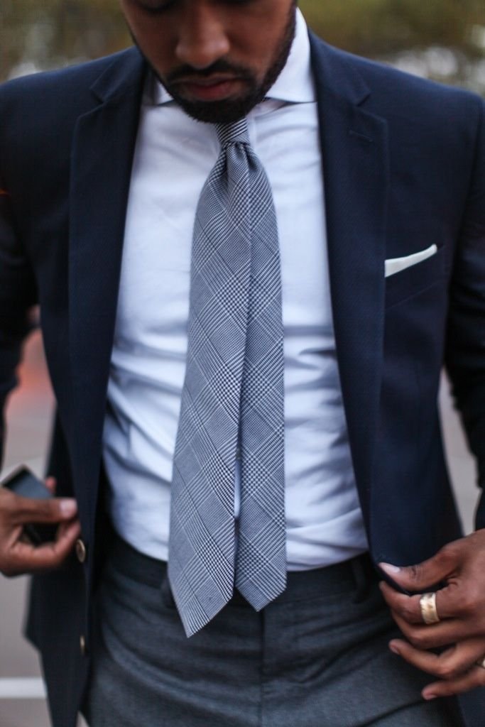 Navy jacket, white shirt & pocket square, grey pants and plaide tie. amazing combo