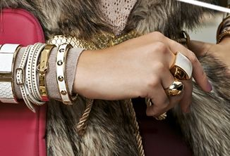 Stacking bands, watches and bracelets add movement to any static outfit creating energetic excess