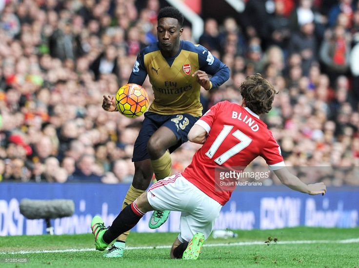Danny Welbeck of Arsenal breaks past Daley Blind of Man United during the Barclays Premier League match between Manchester United and Arsenal at Old Trafford on February 28, 2016 in Manchester, England.