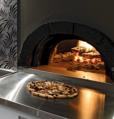 Concealed Pizza Oven    A feature talking point of any outdoor living area. Pizza ovens not only have the beauty of naked flame but also the ability to cook a large variety of meals. This pizza oven has been concealed within the storeroom behind, allowing for a clean minimalist look to the alfresco kitchen.    www.woodfiredovens.com.au
