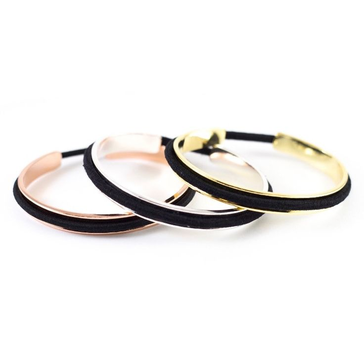 Bangle bracelet for work... hidden hair tie for WERQ! Always be prepared for the gym with this metal cuff bracelet which holds a ponytail elastic. Change out the hair tie to match your outfit and crea