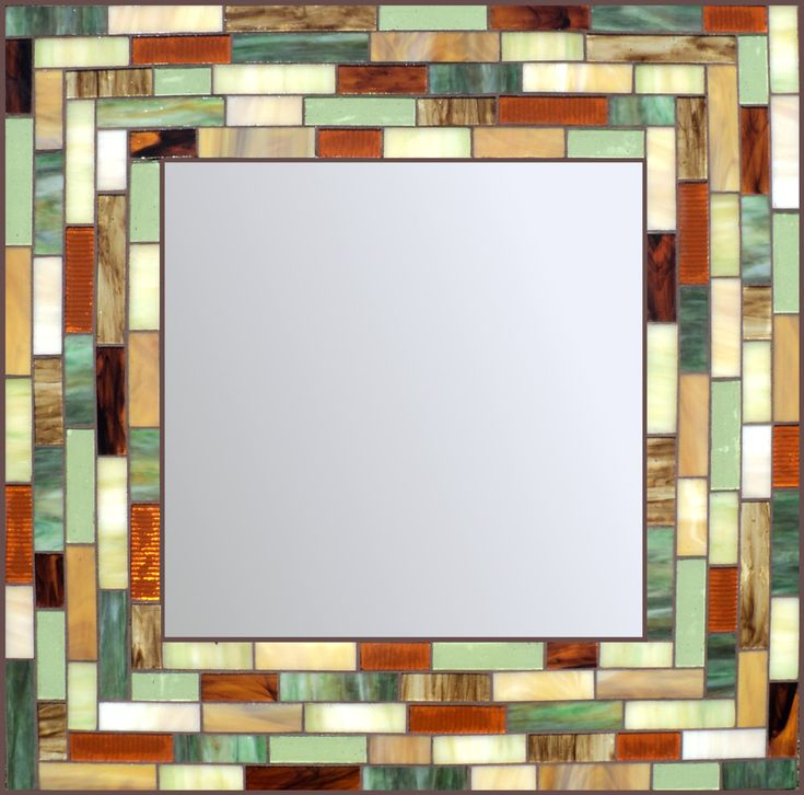 Made with hand cut stained glass. Mirror size is 14x14. Total size is 24x24. Glass colors are shades of green, brown, gold and cream with sealed