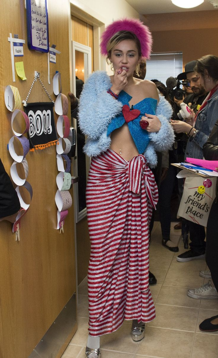 Miley took to dorm rooms to campaign for Hilary Clinton in October 2016 wearing a haphazard, patriotic look.