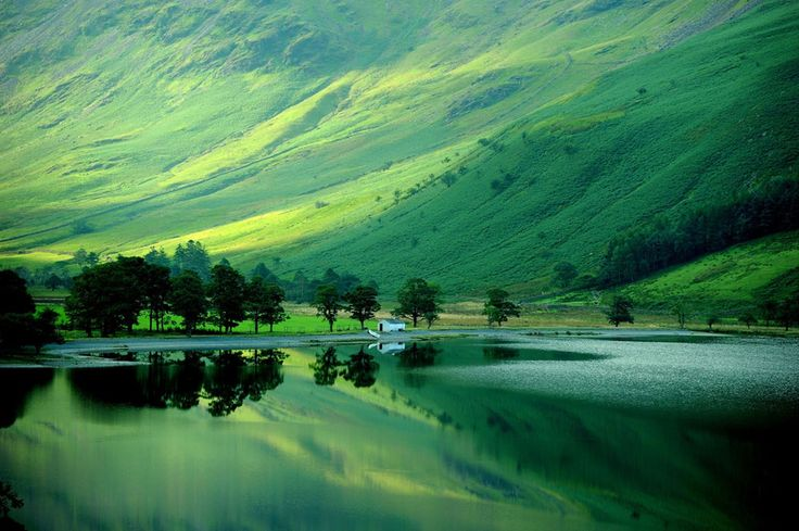 Early autumn reflections in Buttermere in the Lake District in Cumbria