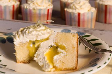 White chocolate cupcakes with lime and passionfruit curd and swiss meringue buttercream
