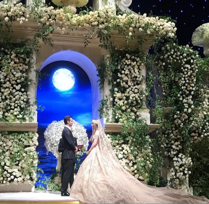 The offspring of two wealthy Russian businessmen married in L.A. at the Dolby Theatre among a half-million dollars worth of floral decor, and a gold-painted aisle.       In a lavish, $10 Million dollar wedding, Russia's wealthiest families flaunted their worth by flying in Lady Gaga and Jason
