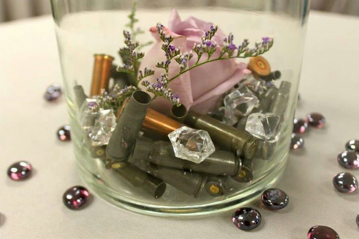 Gun themed Wedding using spent shell casings, roses and some bling on the high top centerpieces.
