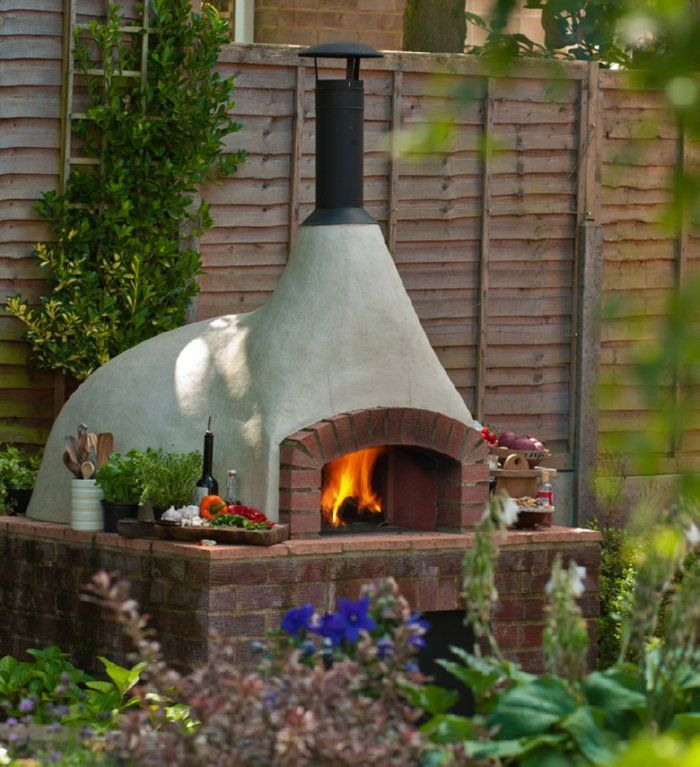 earth oven with wood storage underneath