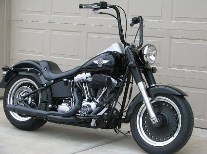 harley fatboy with black ape hangers, different handle bars, but I would love this between my legs