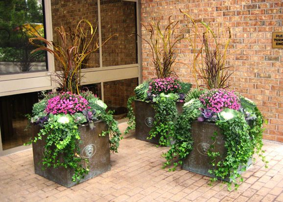 fall foliage in wrought iron planters   Fall Planters from the Urban Garden