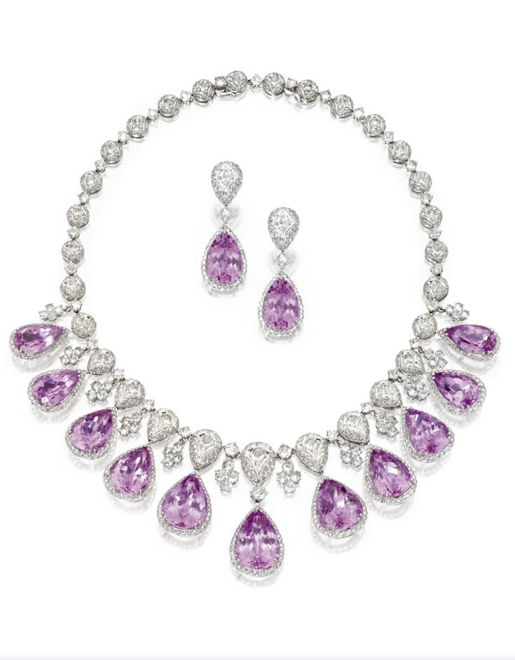 Kunzite and diamond necklace and earclips. The necklace set with pear-shaped kunzites weighing approximately 146.00 carats, and rose-cut diamonds weighing approximately 21.00 carats, mounted in 18 karat white gold, length 16 inches; the earclips set with pear-shaped kunzites weighing approximately 22.70 carats, and rose-cut diamonds weighing approximately 2.50 carats, mounted in 18 karat white gold.