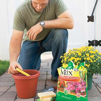 Place a sponge in the bottom of a planter before adding soil, to keep water in reserve.