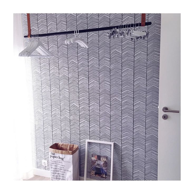 ferm LIVING Herringbone wallpaper and clothes rack: http://www.fermliving.com/webshop/shop/wallpaper/herringbone-wallpaper.aspx  http://www.fermliving.com/webshop/shop/new-collection/clothes-rack.aspx
