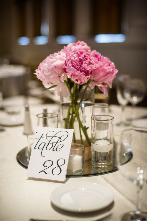 Simple pink peony centerpiece on a mirror base with