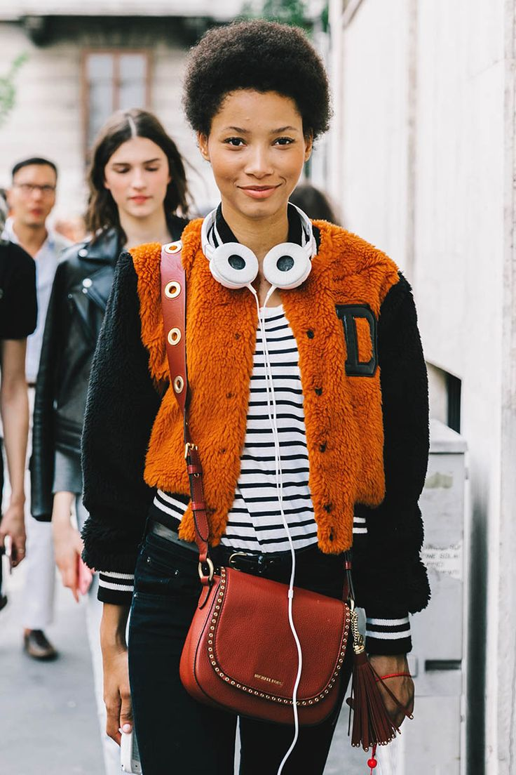 Street Style : faux fur body bomber jacket with sports detailing worn back with striped t-shirt and skinny pants || Saved by Gabby Fincham ||