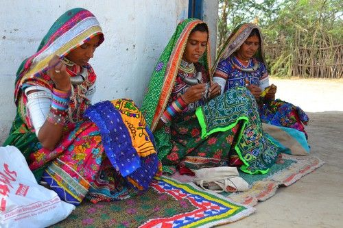 Women artisans employed in the craft of Kutch embroidery, in India.
