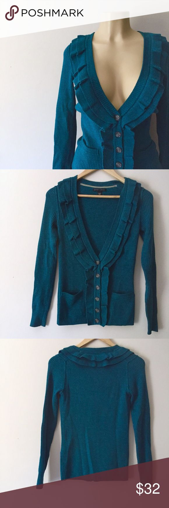 """[Banana Republic] Teal Cardigan Sweater Top Ruffle Banana Republic Teal Cardigan. Ruffle accent. V-Neckline with ruffles, 2 Front Pockets. Long Sleeves, Cable Knit Sweater. Comfortable Knit Sweater Top. Front Button up Closure. stretchy. No lining. Merino Wool Blend. Made in China.  Measurements are Flat Across.  ▪️Pit to Pit: 17.5"""" ▪️Length: 25.5"""" ▪️Hips: 14.5""""  ▪️Condition: Great Condition. No Flaws. No Fading.  ▪️Retail: $98.00 #16621165 Banana Republic Sweaters Cardigans"""