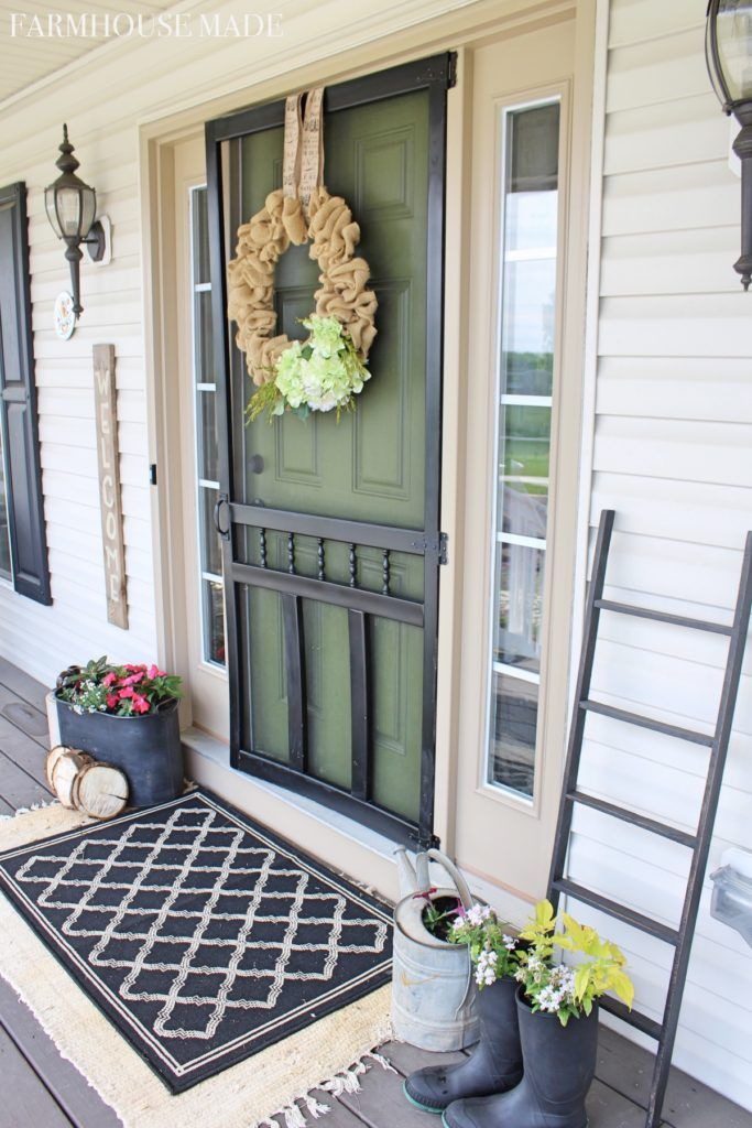 It's almost time for a Springtime Porch Tour! This is our farmhouse porch landing with double rugs, blanket ladder, and burlap wreath of welcoming!