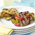 A simple, winning meal, Grilled Cube Steaks and Peppers with Potato Planks, call for just 10 minutes of prep time. #recipes #dinner
