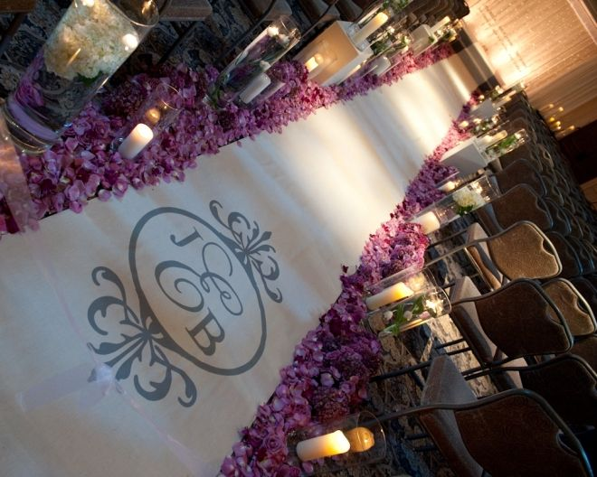Dramatic wedding ceremony aisle with monogrammed runner, candles and tons of purple rose petals {Evantine Design, Eventions Productions, Photo: Phil Kramer}