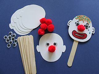 Clown Face Puppets...some child will enjoy this even if it does totally freak me out...