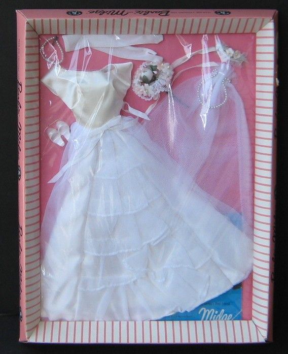 This is the most common of several vintage Barbie bridal fashions, Bride's Dream. It was available from 1963-1965. It consists of:    whit...
