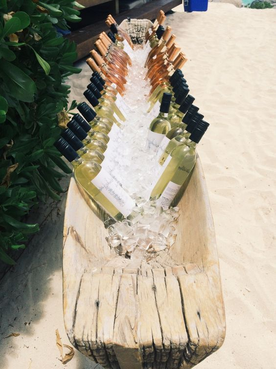 Chilling wine in a log / http://www.deerpearlflowers.com/driftwood-wedding-decor-ideas/2/