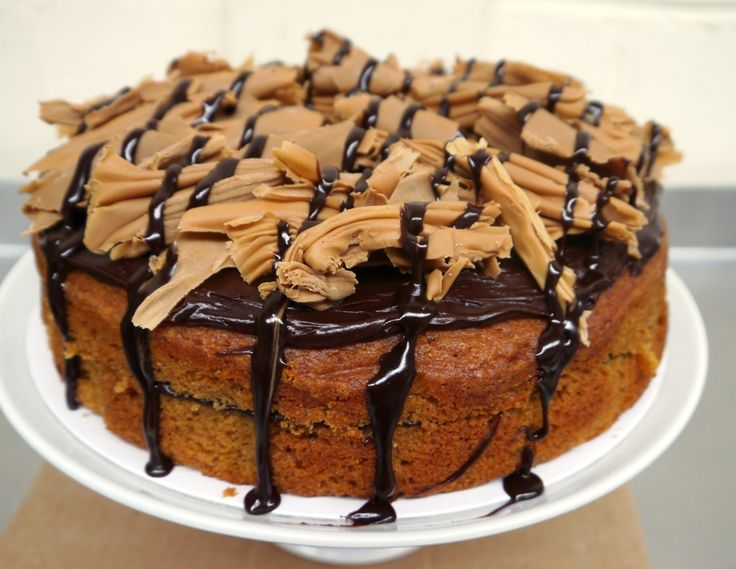 Toffee and chocolate, what a combination! Our toffee cake is sandwiched and topped with rich chocolate fudge and finished with caramel toffee chocolate curls and drizzled with rich chocolate fudge. A treat for any occasion. Serves 12