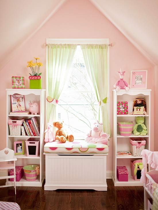 A great play room with low shelves for little ones to easily reach all of their toys!