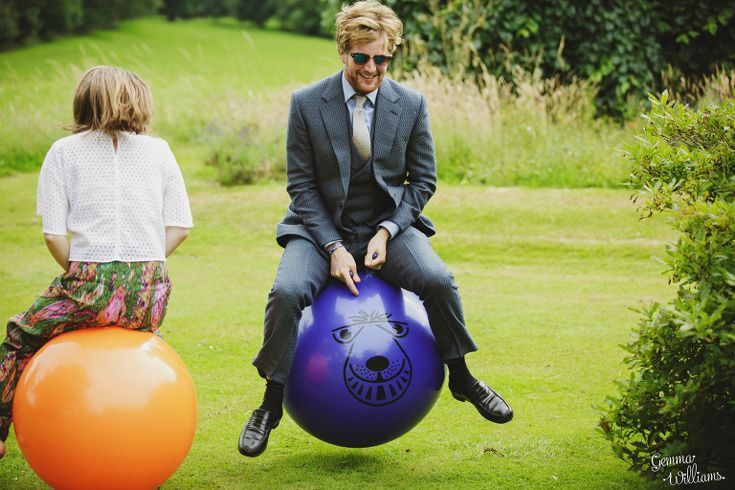 guests riding space hoppers at wedding reception - wedding games #rusticweddinginspiration