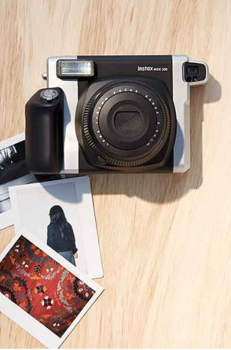 The newest instant picture trend, Fuji Polaroid camera, sold at Best Buy & Michaels