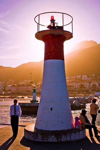 Kalk Bay (South Africa). 'This delightful False Bay fishing village offers an abundance of antique, arts and craft shops, great cafes and restaurants, plus a lively daily fish market at its harbour.' http://www.lonelyplanet.com/south-africa/cape-town/sights/harbour-port/kalk-bay-harbour