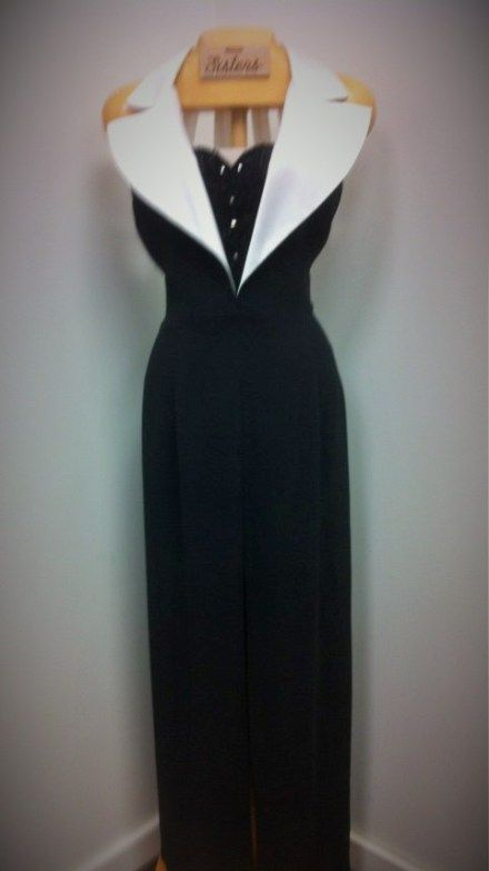 Luxurious, tuxedo-style, long black-and-white dress with front slit by Ever Beauty.