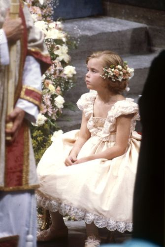 A very sweet bridesmaid Alice (Sarah Ferguson's half sister), dressed in a pale peach Victorian style dress, at the wedding of Prince Andrew, Duke of York and Lady Sarah Ferguson (Duchess of York) at Westminster Abbey on 23 July 1986.