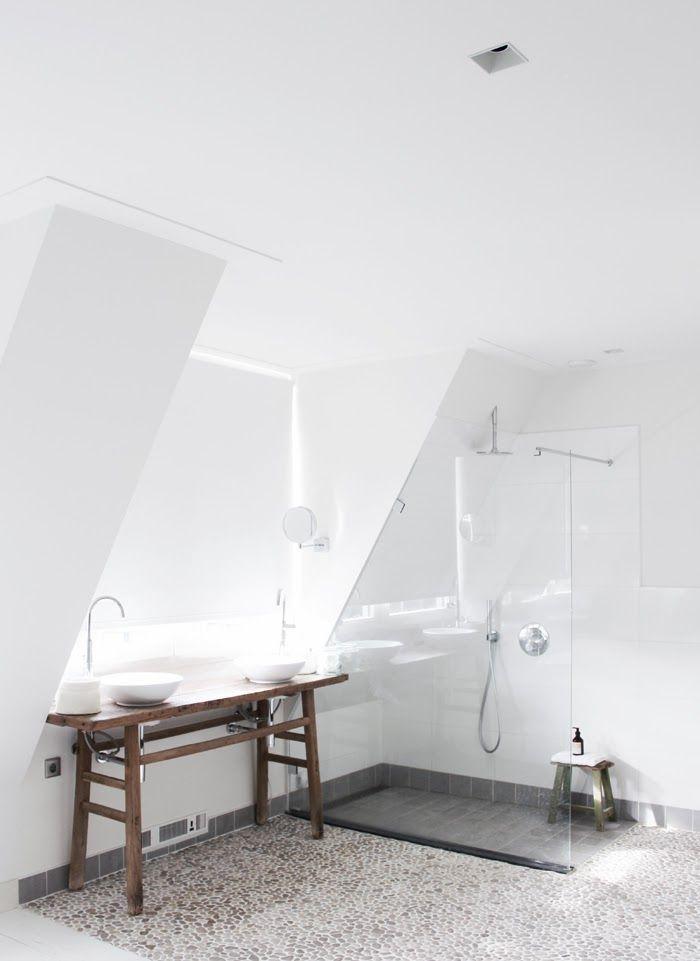 Beautiful light and airy Dutch bathroom with a Bali Cloud pebble tile floor.
