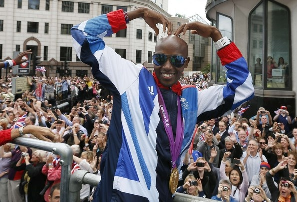 Gold Medal winner athlete Mo Farah performs his 'mobot' during the London 2012 Victory Parade for Team GB and Paralympic GB athletes on September 10, 2012 in London, England.