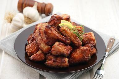 Crock-Pot Chicken Wings in a Tasty Garlic Ginger Sauce: Easy crock pot chicken wings with Asian flavors.