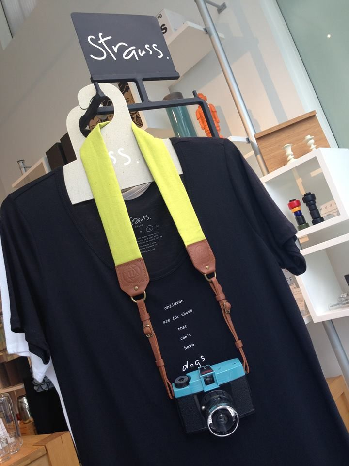 "One of our most popular T Shirts by Strauss - ""Children are for those that can't have dogs"" - shown here with Camera Strap in Citrus/Tan by Sitting Pretty. Strauss & Sitting Pretty are both local Auckland brands. http://theobjectroom.co.nz/products/spcsctt/sitting-pretty-camera-strap-citrus-tan"