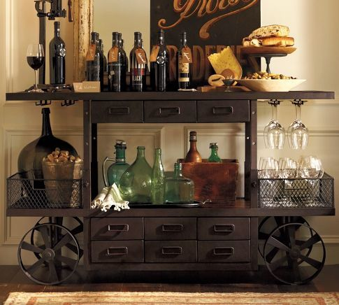 A bar cart is much better to store your alcohol than in a cabinet. Plus, even if you keep this one is empty, it still looks awesome