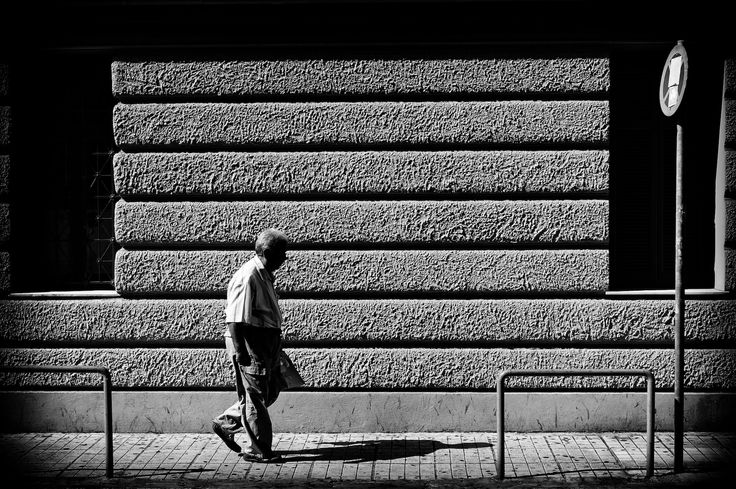 This is the wall of the Ipokratio Hospital in Athens. I like the fact that it has many parallel horizontals. It is also rich in texture and so I find that it is an interesting background. As I was studying the wall, this old man walked in front of it. He was preoccupied with something, lost in thought. I had already framed so all I had to do was click the shutter button. Snap!
