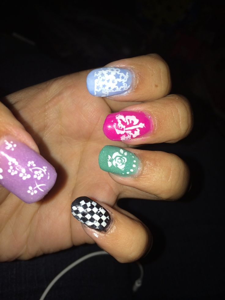 Glow in the dark acrylic nails and white nail polish stamp designs