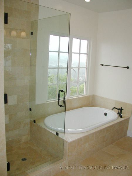shower next to tub design | Frameless shower enclosure and soaking tub with custom marble tile in ...